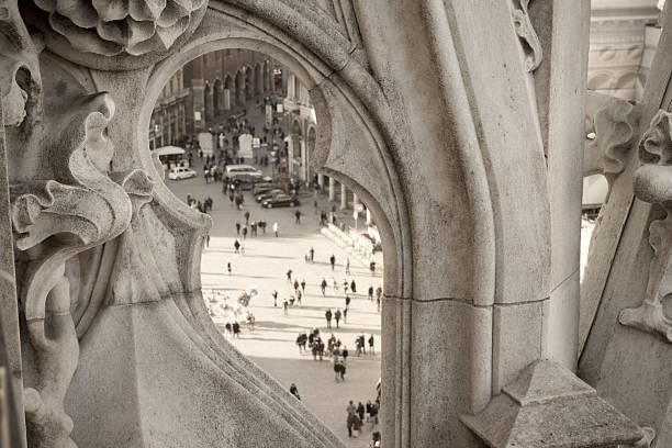 Looking Milan through Duomo cathedral stock photo