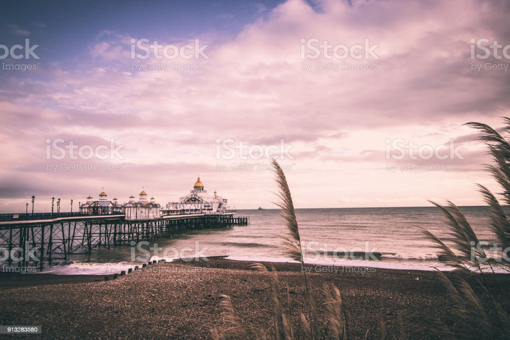 Looking out along the beach next to Eastbourne Pier stock photo