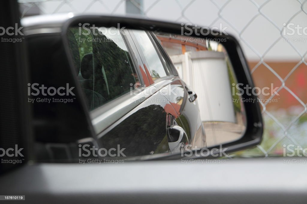 Looking Out Car Window withReflection in Side Mirror stock photo