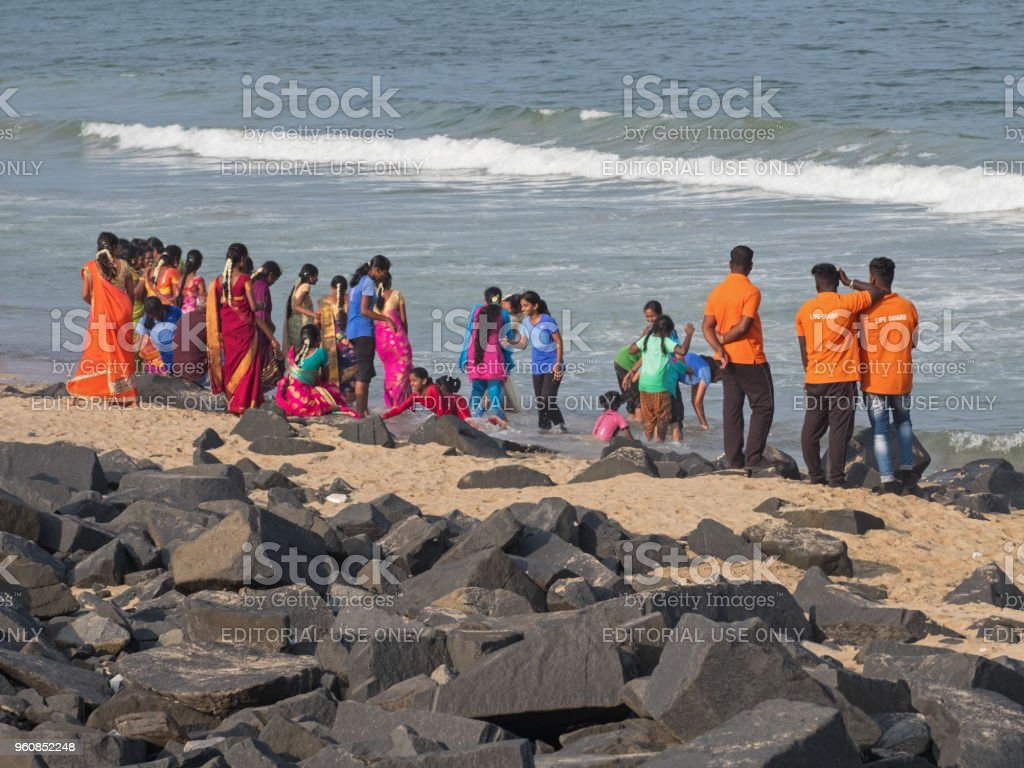 Looking out for the wellbeing of others at the Indian seaside stock photo