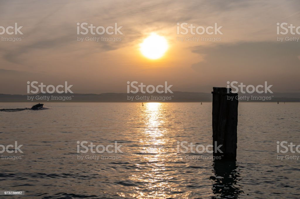 Looking out on to Lake Garda from the town of Sirmione in Lake Garda, Italy at sunset stock photo