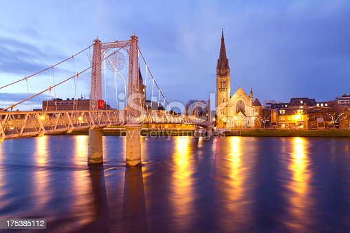 A tranquil scene of Inverness water front at Twilight. The capital city of the highland in Scotland and a popular place with tourist visiting the country.The photograph was captured at twilight with a long exposure creating motion blur in the river and clouds.