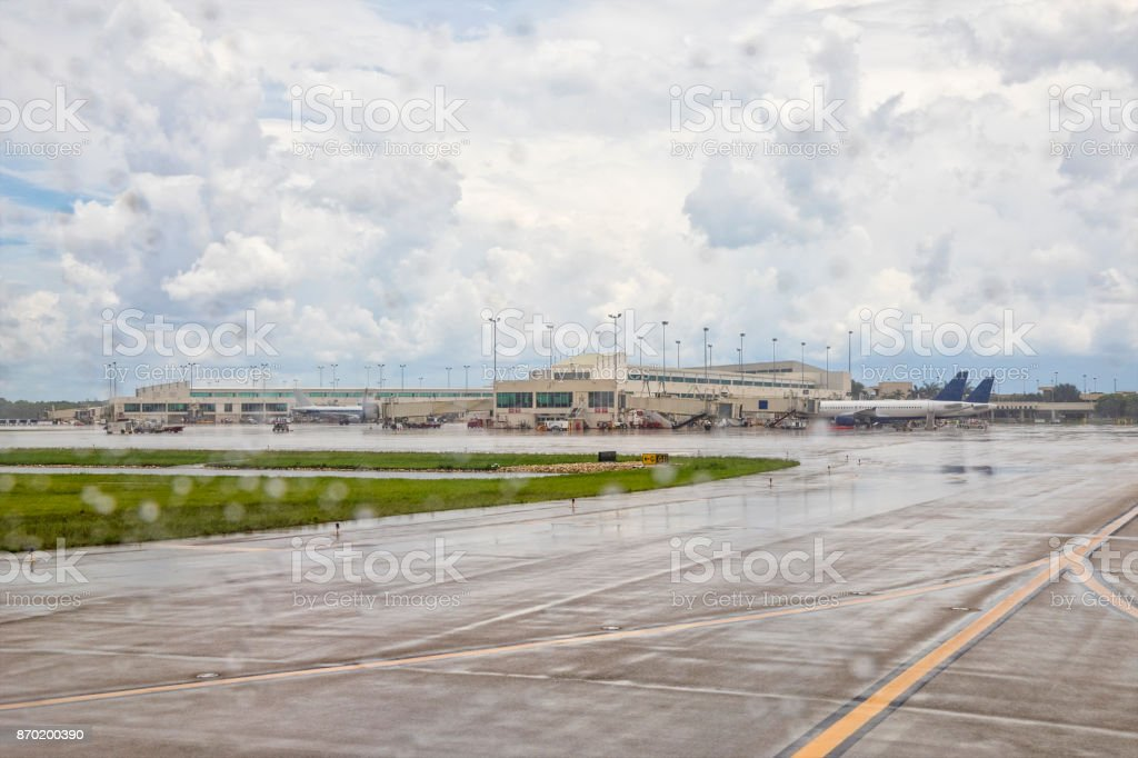 Looking out plane window back at Southwest Florida International Airport stock photo