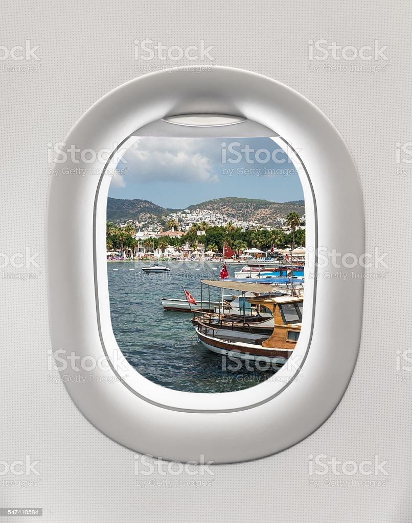 Looking out the window of a plane to the harbor stock photo