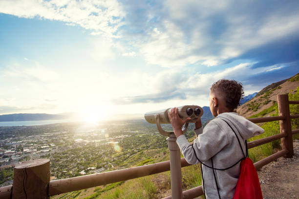 Looking out through binoculars at a beautiful mountain view stock photo