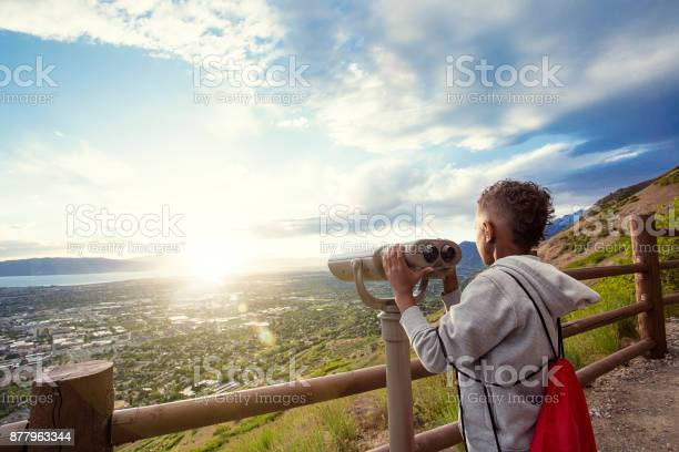 Photo of Looking out through binoculars at a beautiful mountain view