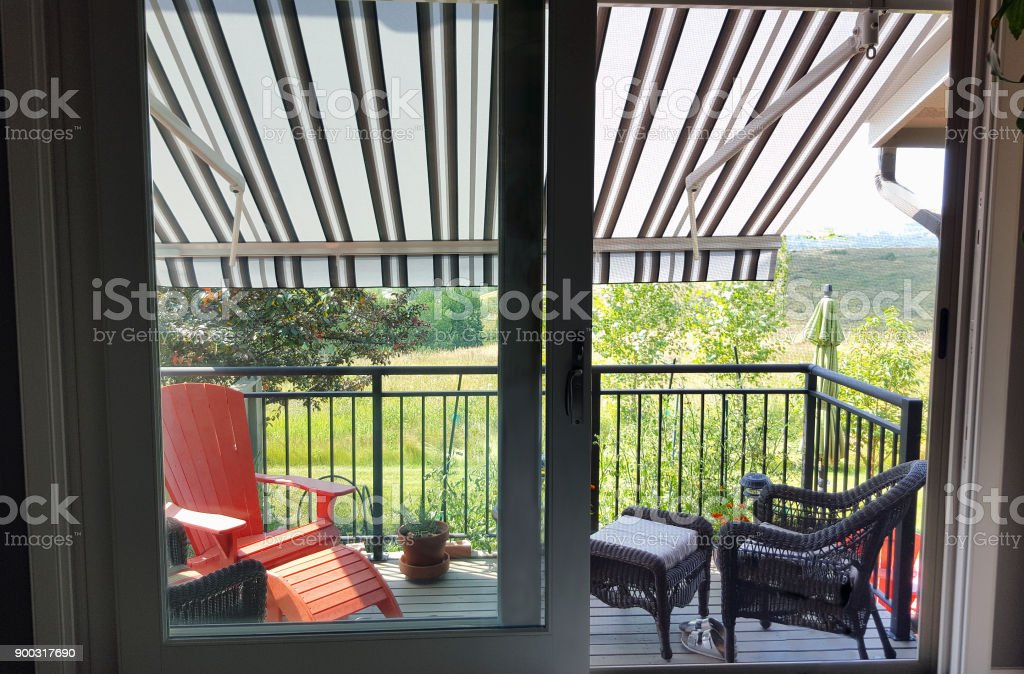 Looking Out To A Cool Awning Shaded Deck stock photo
