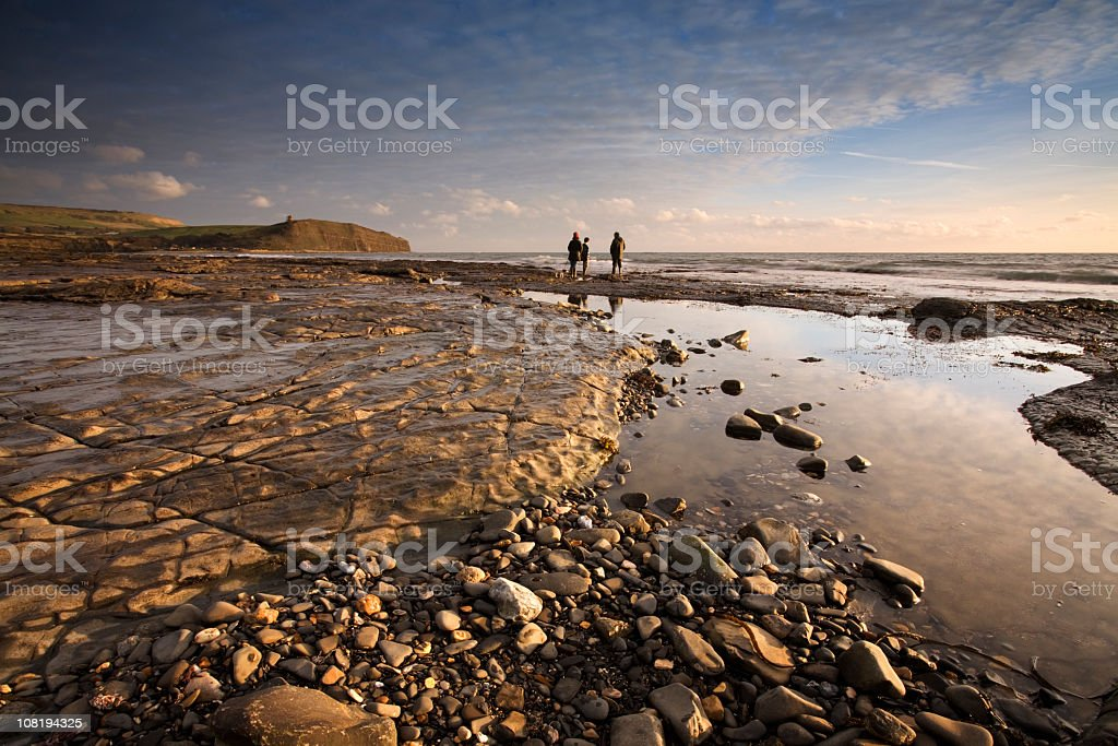 Looking Out Towards Kimmeridge Bay with Family Walking Dog stock photo