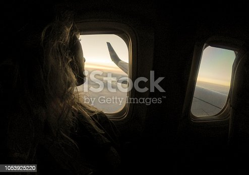 Girl who looking from window airplane