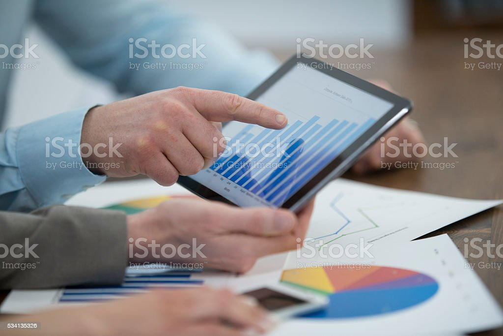 Looking Over Annual Reports stock photo