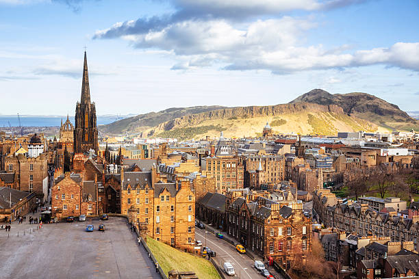 Looking Over Edinburgh Old Town To Arthurs Seat Looking over the buildings and roofs of Edinburgh Old Town to the cliffs of Salisbury Crags and the peak of Arthur's Seat. theasis stock pictures, royalty-free photos & images