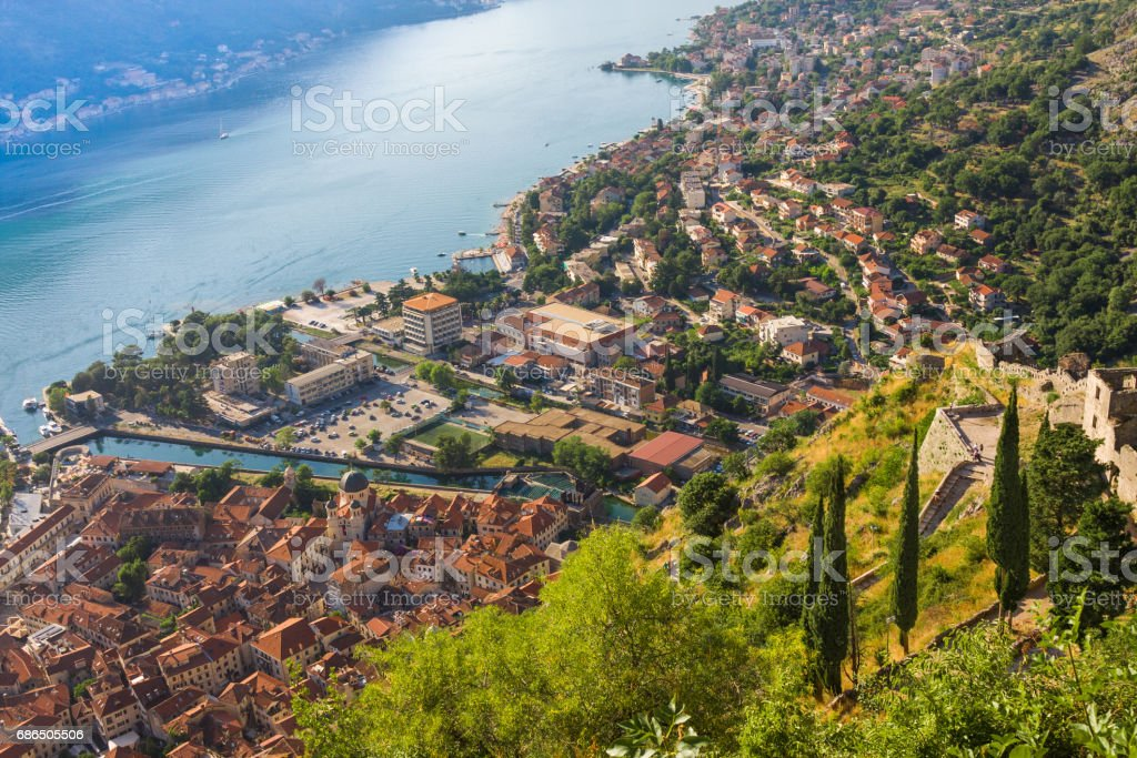 Looking over the Bay of Kotor in Montenegro with view of mountains, boats and old houses with red tile roofs zbiór zdjęć royalty-free