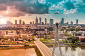 Warsaw skyline behind the bridge with light leak, Poland