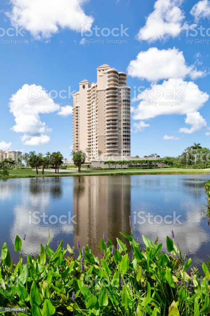 Looking over waterway at a highrise condominium in Bonita Springs Florida stock photo