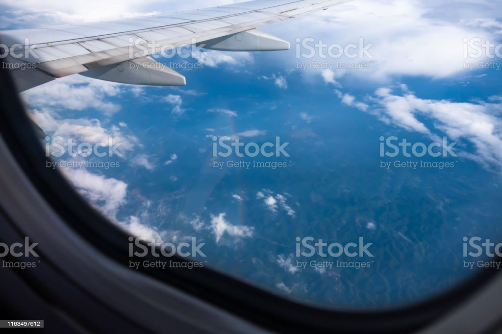 Looking rainbow through airplane window