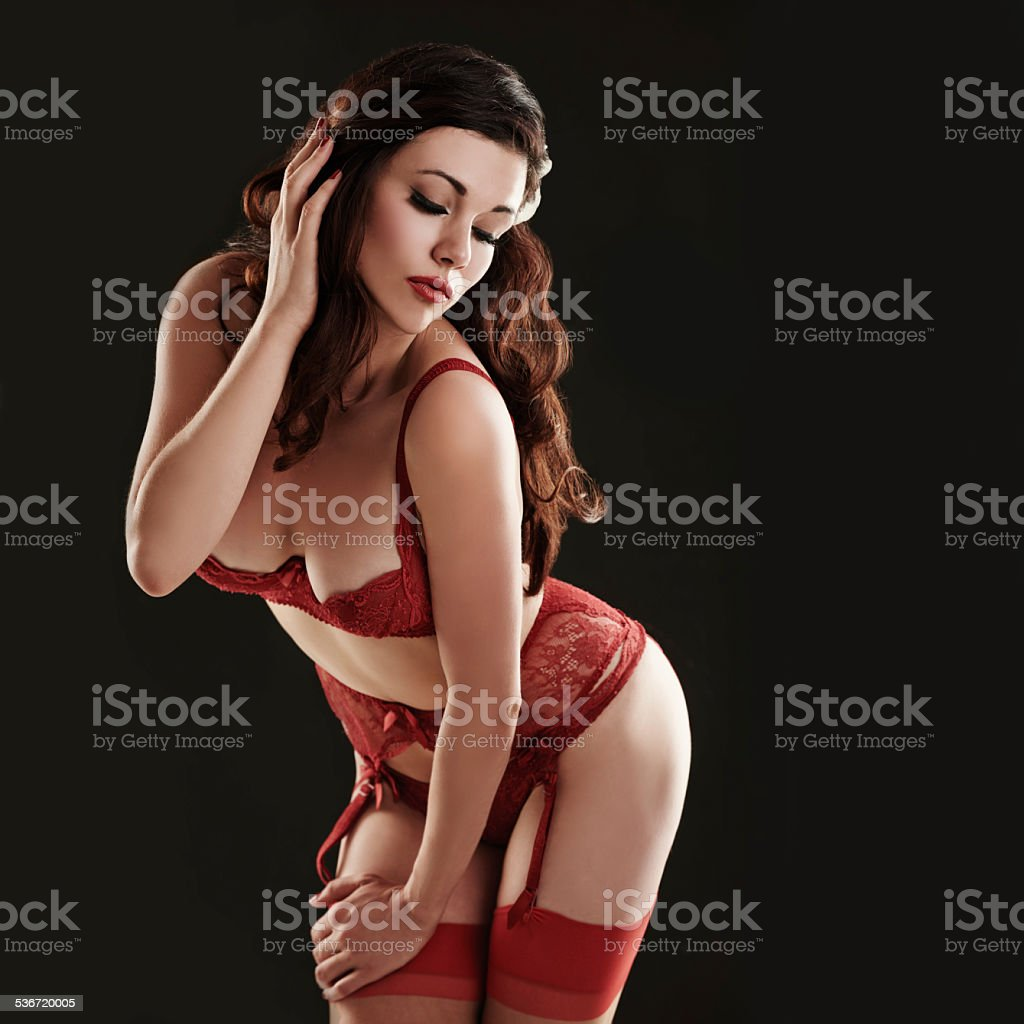 Looking sensual in red stock photo
