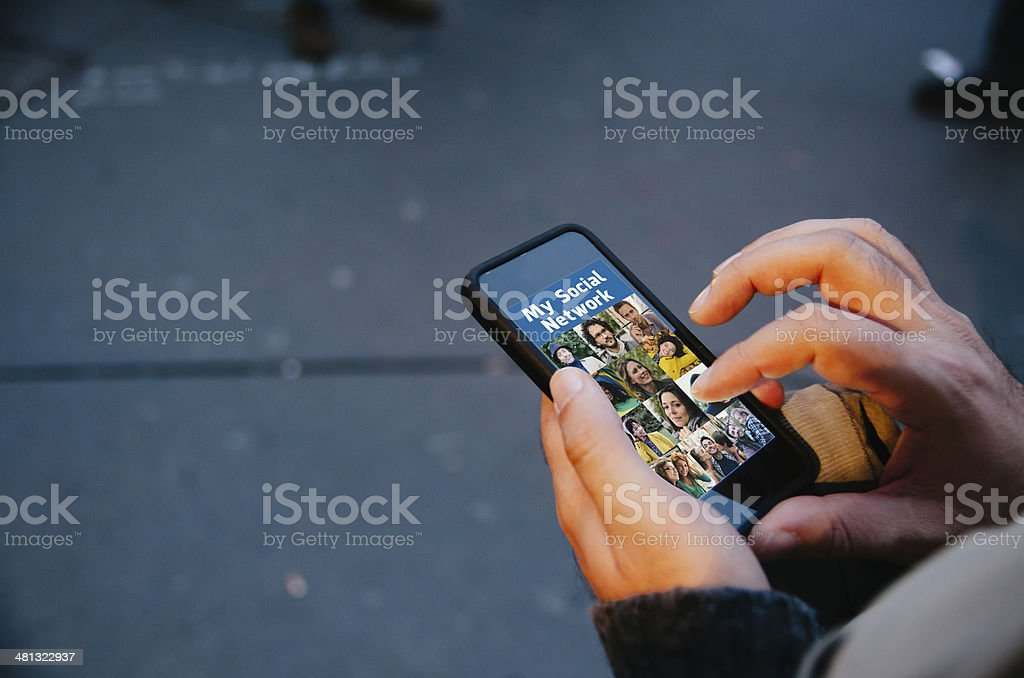 Looking Social Network Website on Mobile Phone stock photo