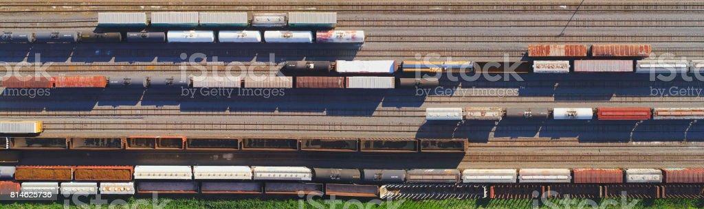 Looking straight down on railroad rail yard, many trains, tracks. stock photo