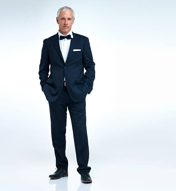 Looking swanky A studio shot of a mature man in a tuxido evening wear stock pictures, royalty-free photos & images