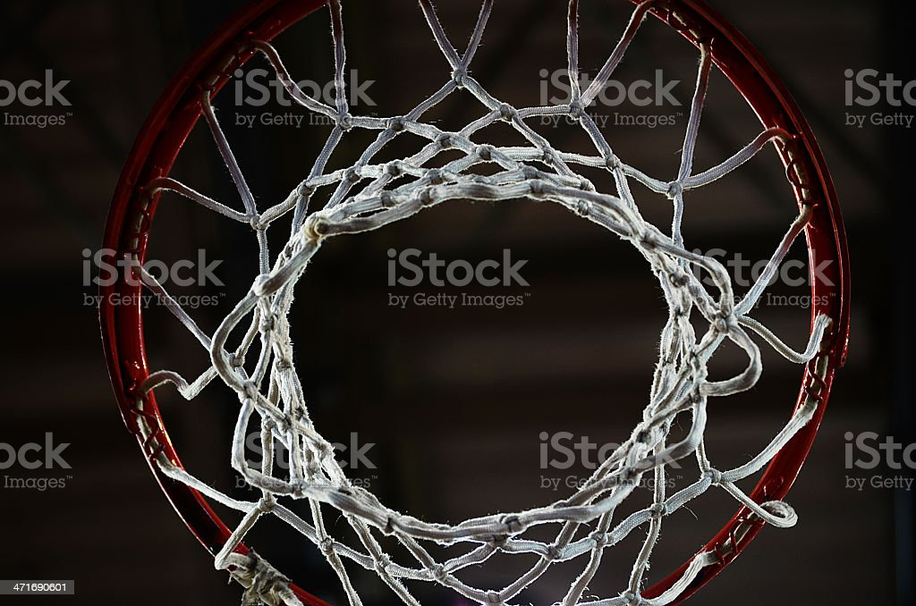 Looking through a basketball hoop in the dark stock photo