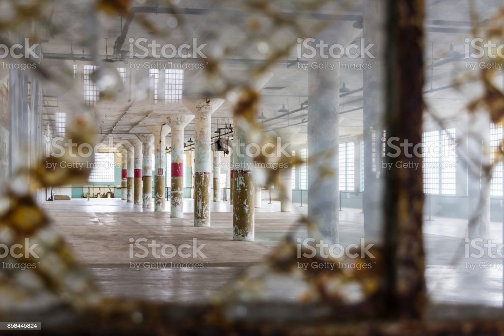Looking through a broken window of the New Industries Building on Alcatraz Island off the coast of San Francisco, USA stock photo