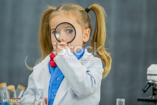 istock Looking Through a Magnifying Glass 647153476