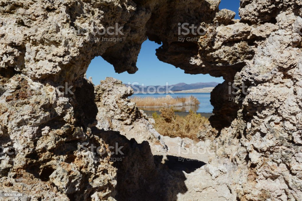 Looking through a natural rock window to Mono Lake in northern California stock photo