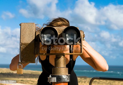 istock Looking Through A Telescope 157375944