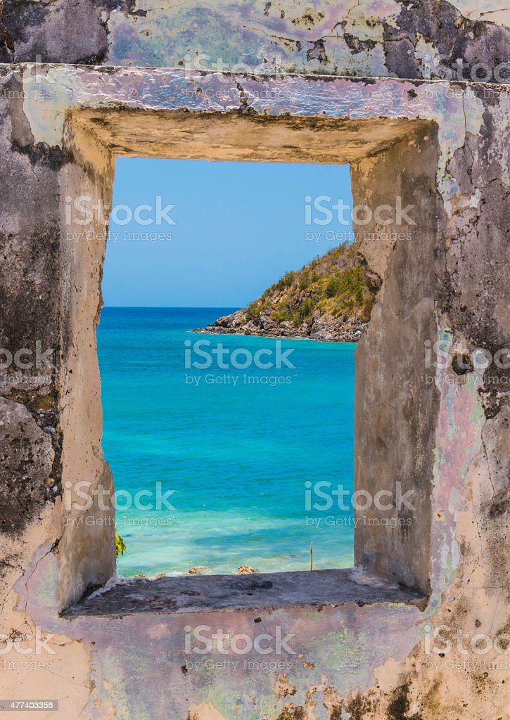 Looking through a window in a ruined sugarmill in St. John stock photo