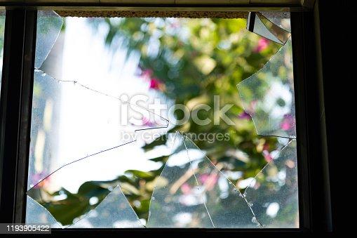 Looking through broken glass window.