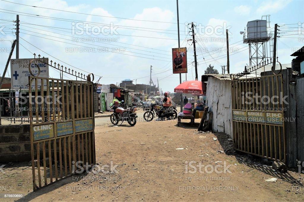 Looking through clinic gates at the Soweto Kayole slum stock photo