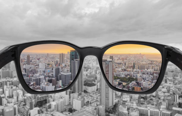 Looking through glasses to city view in sunset. Color blindness glasses, Smart glass technology Looking through glasses to city view in sunset. Color blindness glasses, Smart glass technology lens optical instrument stock pictures, royalty-free photos & images