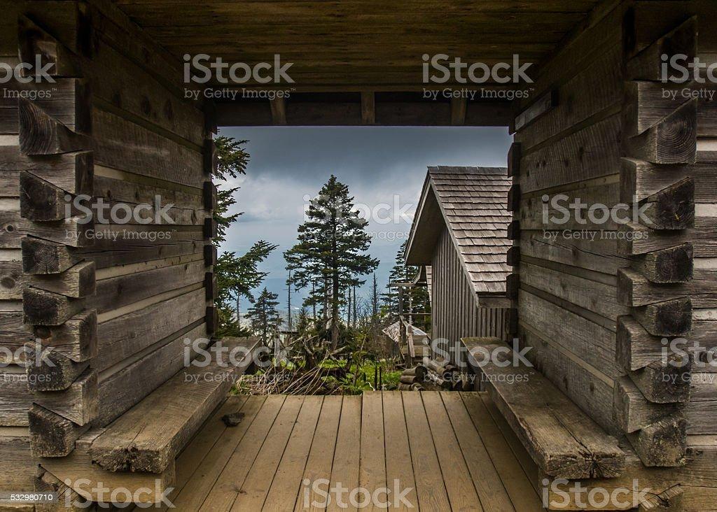 Looking Through Log Frame Building stock photo