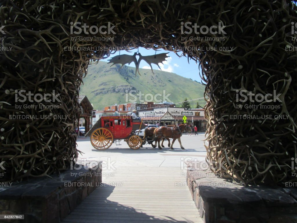 Jackson Hole, Wyoming, USA–June 08, 2014: The antler arches in Jackson Hole town square is home to the world famous Elkfest and Jackson Hole Boy Scout Elk Antler Auction. An annual event that takes place in the center of town during Old West Days and some stock photo