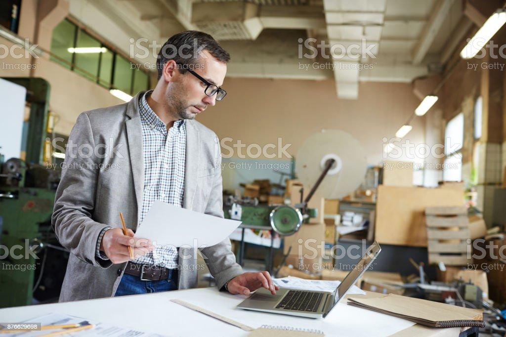 Looking through online data stock photo