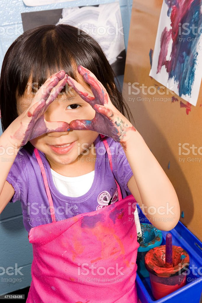 Looking through painted hands royalty-free stock photo