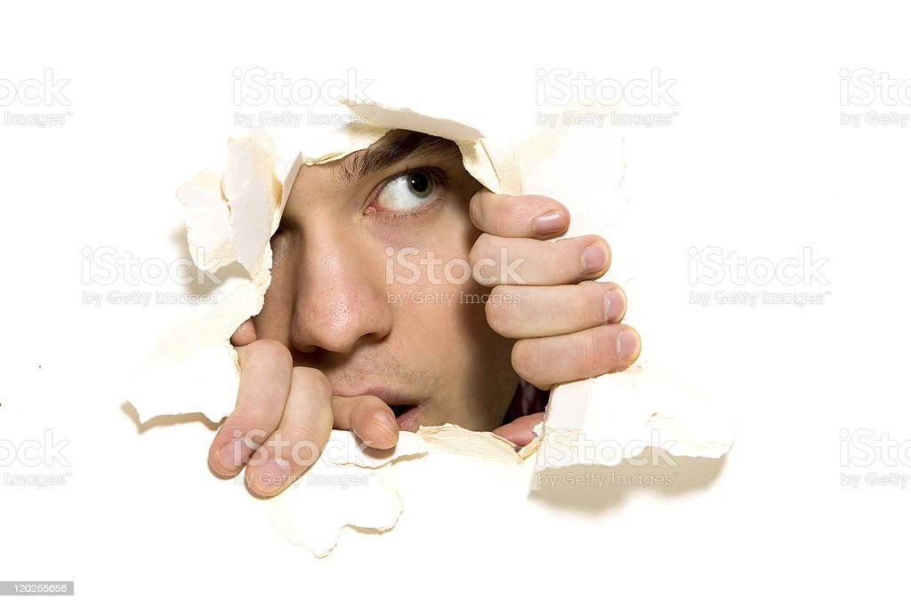 Looking through paper hole royalty-free stock photo