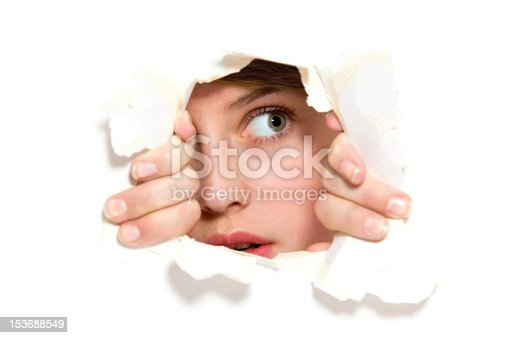 istock Looking through paper hole 153688549