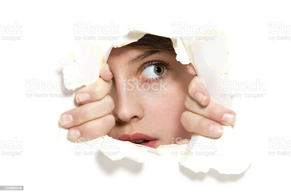 Looking through paper hole stock photo