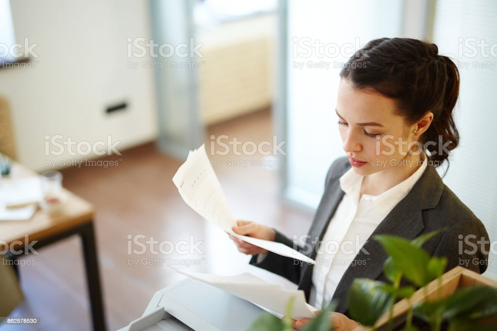 Looking through papers stock photo
