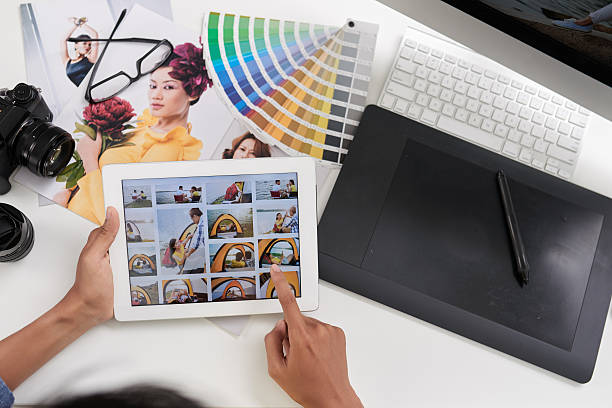 looking through photos - retouched image stock photos and pictures