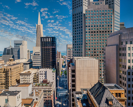 Aerial view between skyscrapers in San Francisco's Financial district. Looking down Sansome Street towards the Bay on a sunndy day.