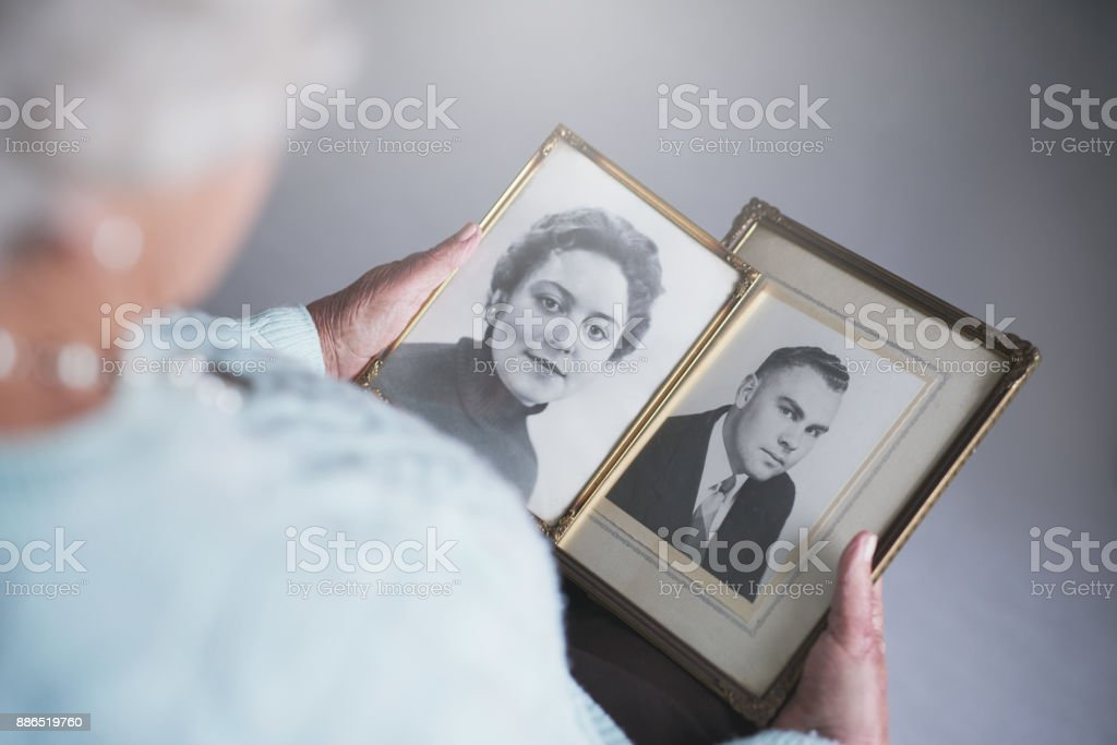 Looking through snapshots from the past stock photo