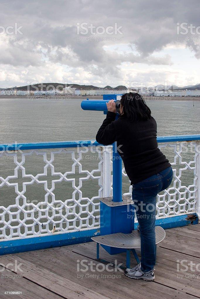 Looking through telescope stock photo
