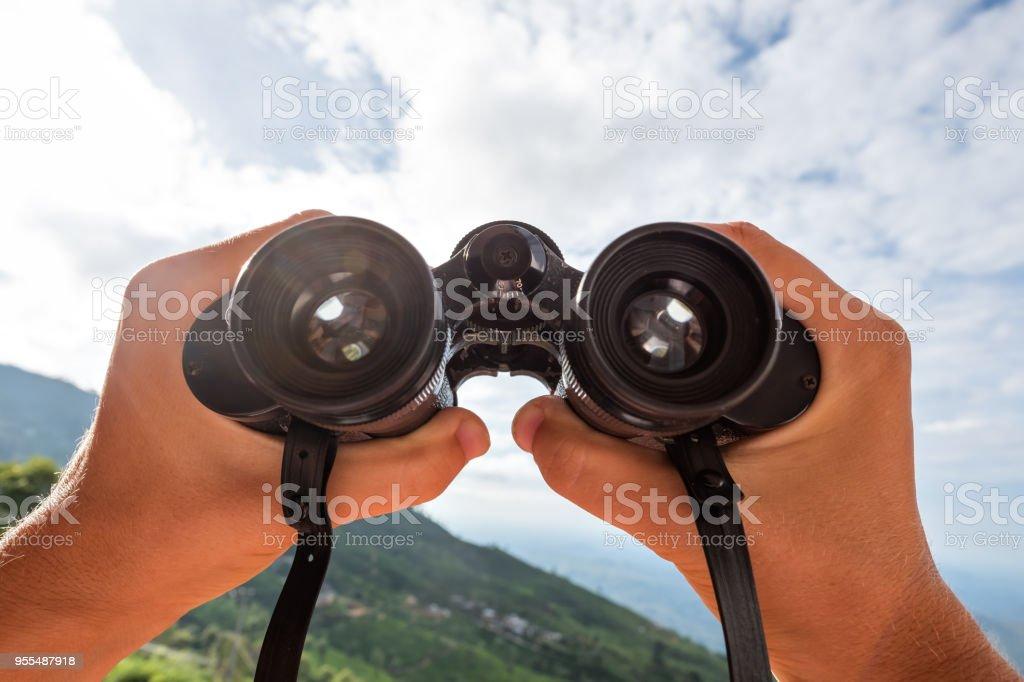 Looking through the binoculars. stock photo