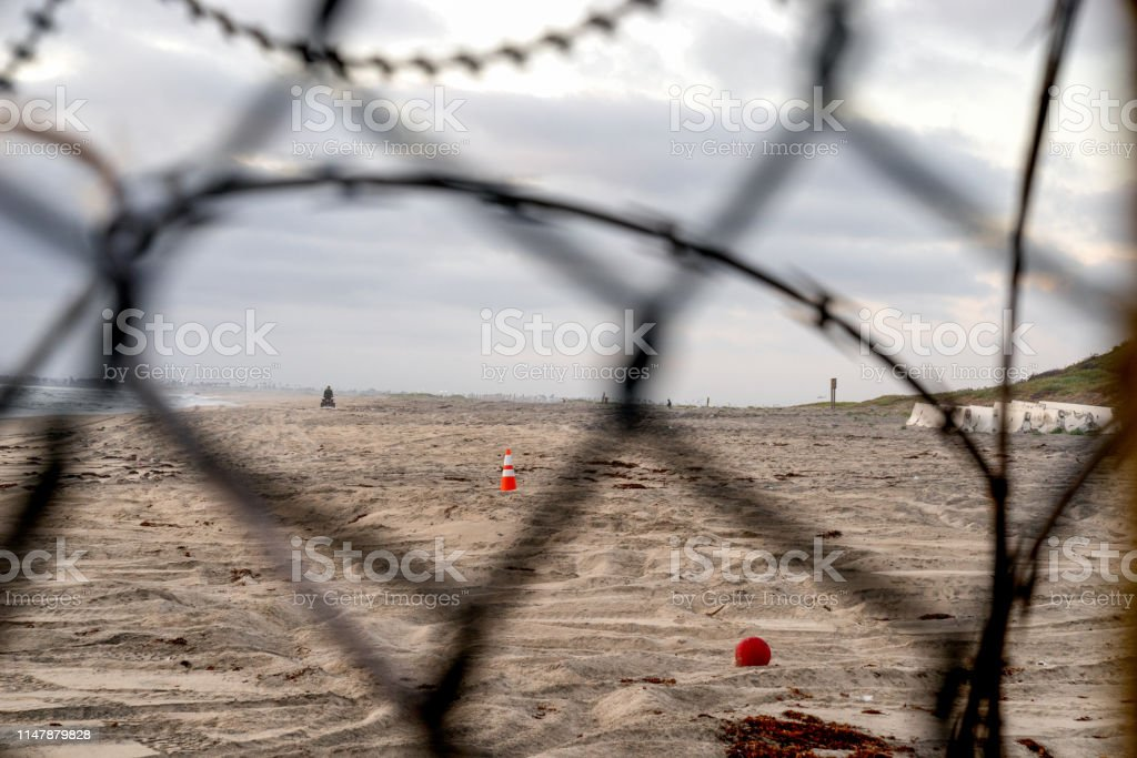 A closeup view of the Mexican side of the International border wall,...