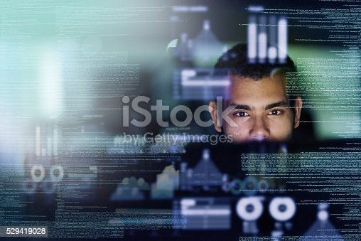 Cropped shot of a young computer programmer looking through data