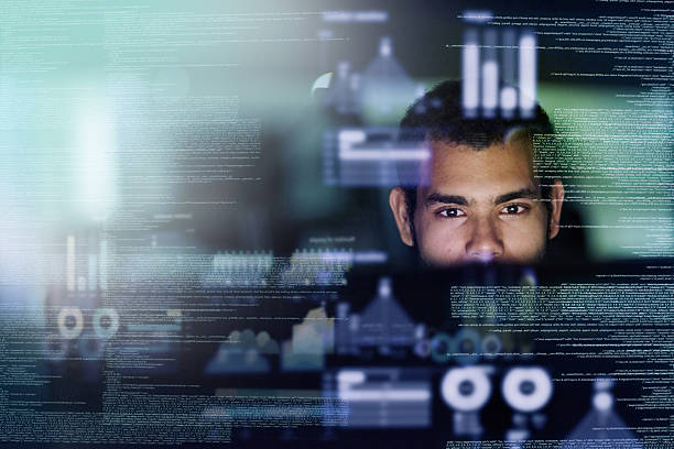Looking through the source code stock photo
