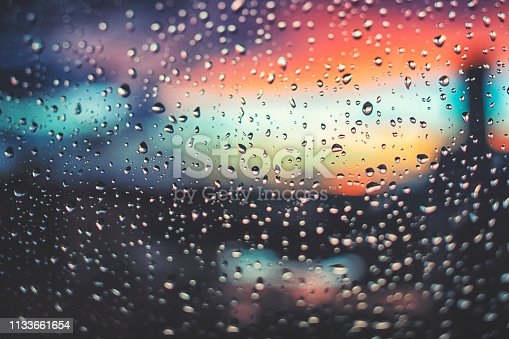 Looking through the window  after the rain in sunset