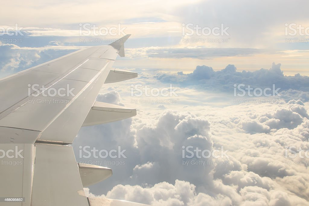 Looking through the window aircraft during the flight stock photo